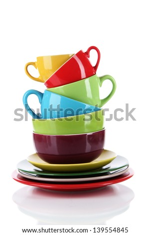 Mountain colorful dishes isolated on white - stock photo