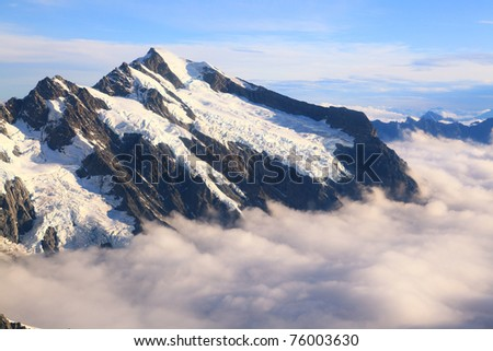 Mountain Cook Peak with mist landscape from Helicopter, New Zealand - stock photo