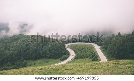 mountain country road in summer at countryside with trees around - vintage film effect