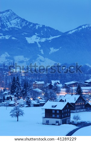 Mountain countryside in winter evening - stock photo