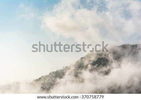 Mountain cover with deep mist.