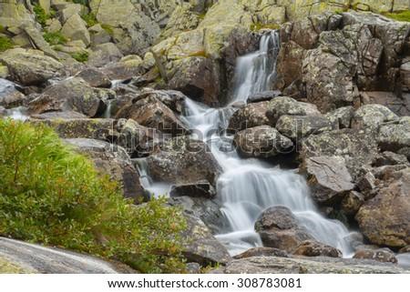 mountain creek waterfall - stock photo