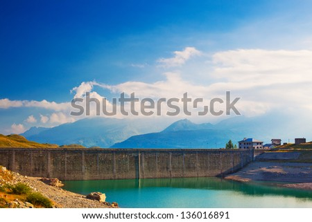 Mountain dam with water in Alps.