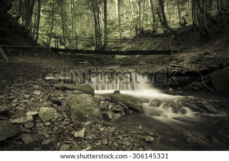 Mountain fast flowing river Shipot waterfall stream of water in the rocks, vintage hipster image - stock photo