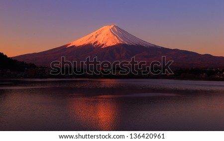 Mountain Fuji at dawn with peaceful lake reflection - stock photo