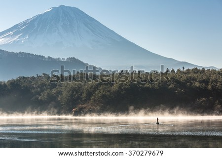 Mountain Fuji in winter sunrise Lake saiko - stock photo