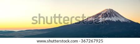 Mountain Fuji in winter sunrise panorama - stock photo