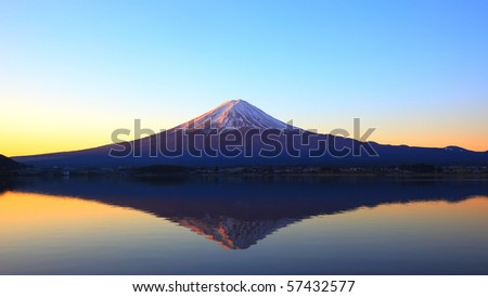 Mountain Fuji reflecting on the lake kawaguchi - stock photo