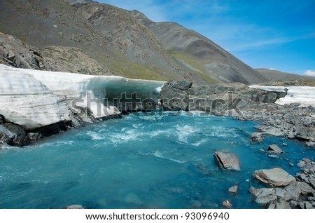 Mountain glacier gives rise to the river - stock photo