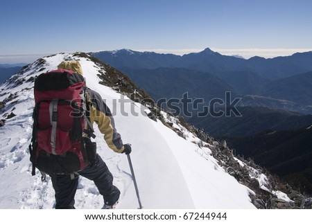 mountain guide with beautiful snow scenery. - stock photo