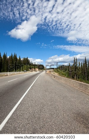 Mountain Highway and blue sky - stock photo