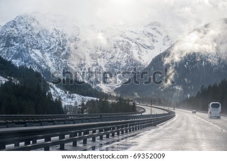 Mountain highway in the austrian Alps - stock photo