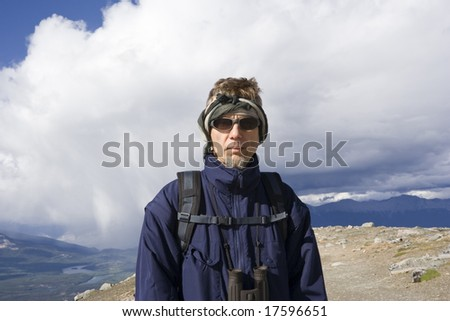 mountain hiker with backpack and sunglasses