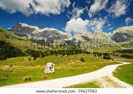Mountain hiking trail in Montasio plateau, Sella Nevea, Italy - stock photo