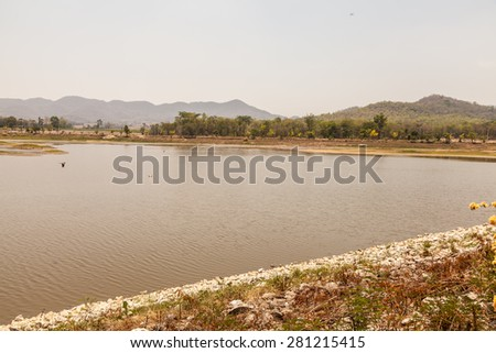 Mountain hill and fields and reservoirs of Rural villages in Thailand