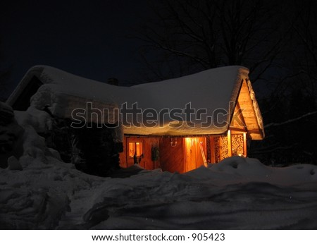 mountain house in the snow at night
