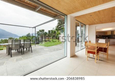 mountain house, modern architecture, interior, dining room, veranda view - stock photo