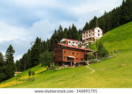 Mountain houses with beautiful sky in Ayder Plateau, Rize, Turkey. - stock photo