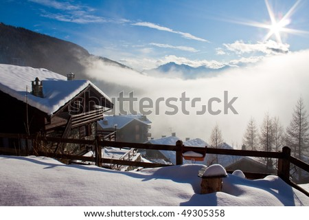 Mountain Hut and snowy landscape - stock photo