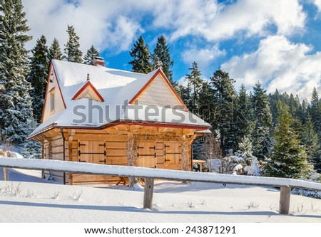 Mountain hut with closed windows in winter landscape - stock photo