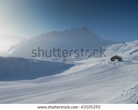 Mountain hut with Extensive ski piste and powder snow off piste. Skiing Les Contamines, French alps - stock photo