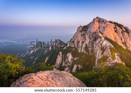 mountain in korea at sunrise located in gyeonggido seoul, south korea. the name of mountain 'Bukhansan'