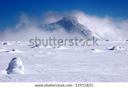Mountain in snow - stock photo