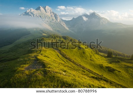 Mountain Komovi in Montenegro. Fog is falling on mountain as sun goes down. Nice as desktop background. - stock photo