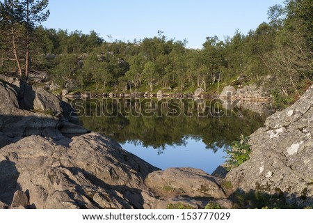 Mountain lake along the Preikestolen mountain trail (Norway) - stock photo