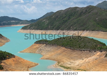 Mountain lake at day - stock photo