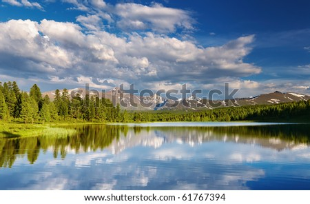 Mountain lake at sunset - stock photo