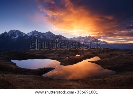 Mountain Lake. Beautiful sunrise. Morning landscape.  Koruldi Lake. Main Caucasian ridge. Zemo Svaneti, Georgia  - stock photo