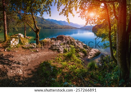 Mountain lake between by mountains  - stock photo