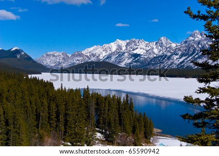 Mountain Lake in Canadian rockies, near Calgary, snow,  ice and water - stock photo
