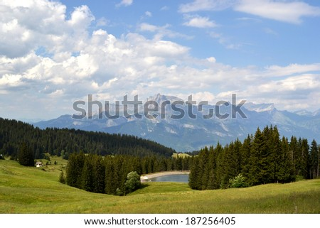 Mountain lake in french alps (Megeve) - stock photo