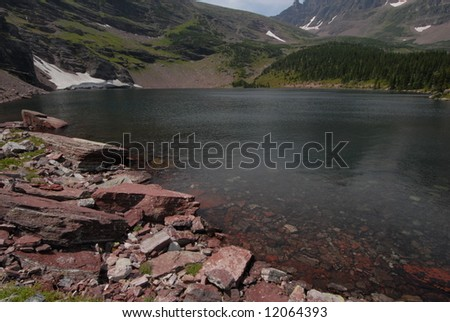 Mountain lake in Glacier - stock photo