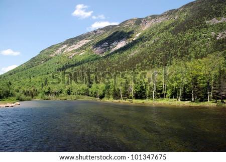Mountain lake in New Hampshire / Mountain Shadow - stock photo