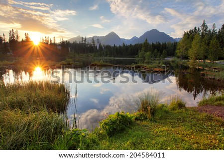 Mountain lake in Slovakia at sunset - Strbske pleso - stock photo