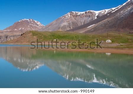 Mountain lake in the morning - stock photo