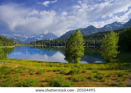 Mountain Lake in the summer with blue sky and clouds