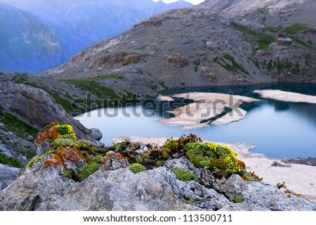 Mountain lake in the Western Caucasus - stock photo