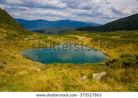 Mountain lake landscape in Ukraine Carpathians, Svydovets ridge - stock photo