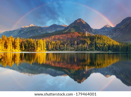 Mountain lake landscape with rainbow - Slovakia, Strbske pleso - stock photo