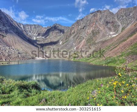 Mountain lake located between the slope of the peak. Eastern Sayan. The Republic Of Buryatia - stock photo