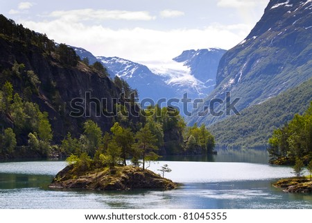 Mountain lake Lovatnet and glacier in Jostedalsbreen national park, Norway