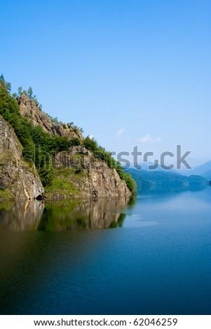 Mountain lake, river dam - stock photo