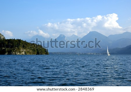 Mountain lake St Wolfgang in Salzkammergut, Austria, with sailboat