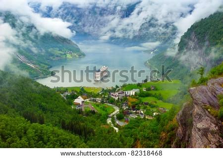 Mountain lake with ship - stock photo
