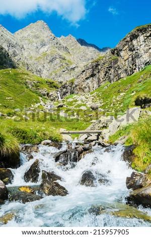 Mountain landscape and river in Valbondione, Bergamo, Italy - stock photo