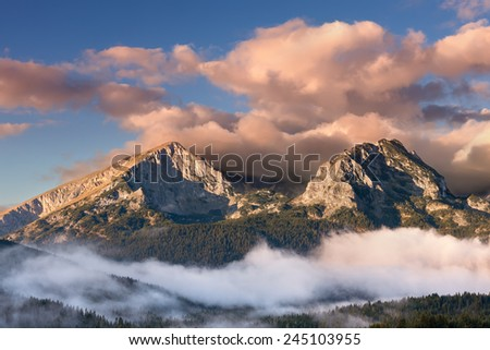 Mountain landscape at sunrise. View on the mountain peaks in National Park Durmitor - Montenegro - stock photo